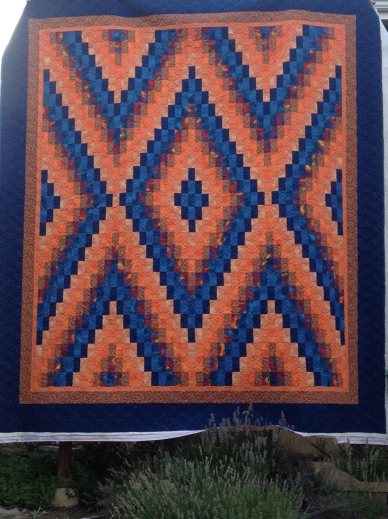 King size quilt with double ribbon strand quilting