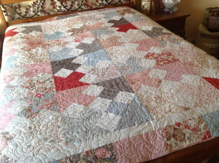 Quilted on computer-assisted long-arm machine.